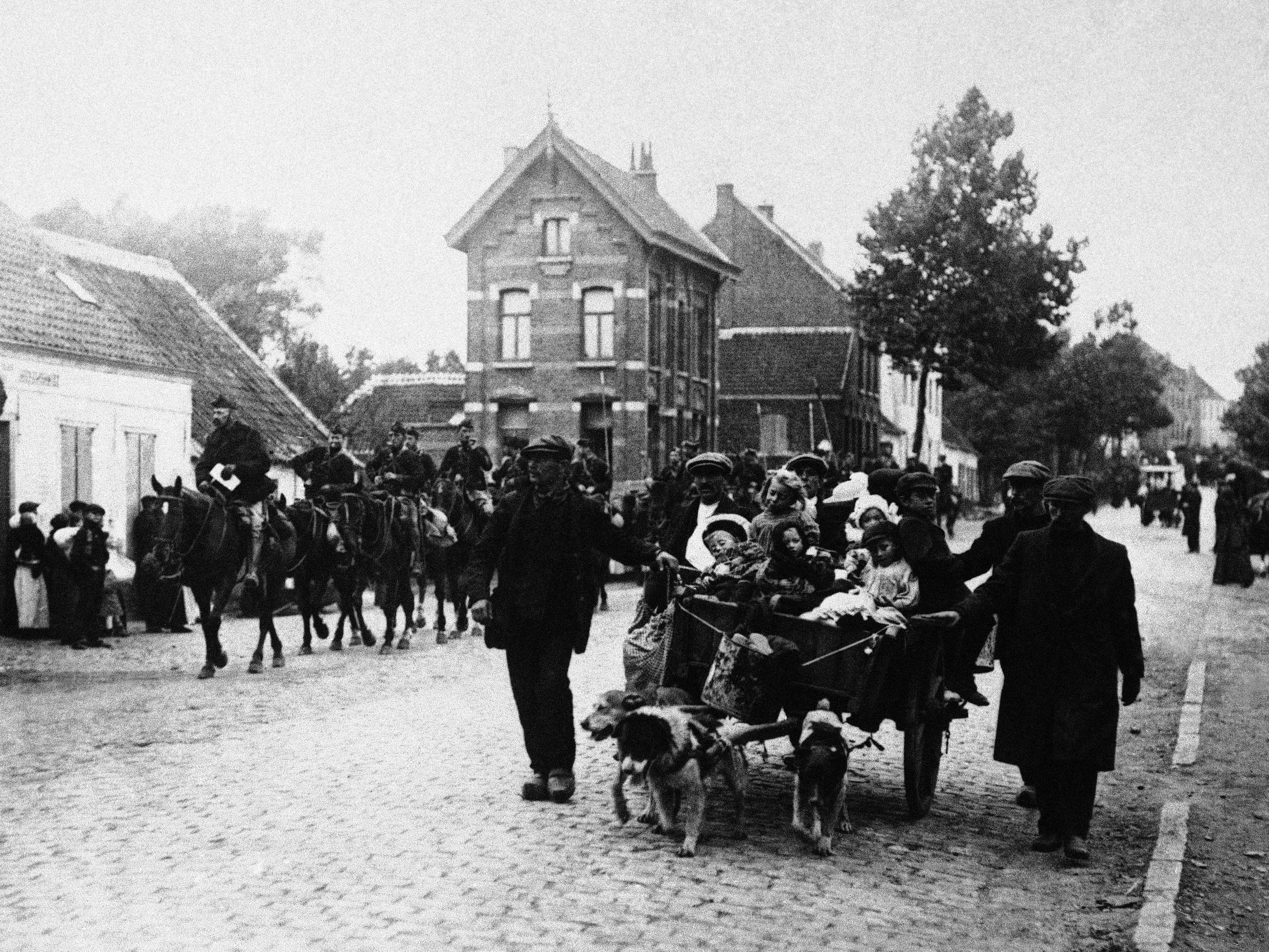 In this Oct. 14, 1914, photo, Belgian civilians and a cavalry detail move out of the pathway of the German advance during World War I in Antwerp.