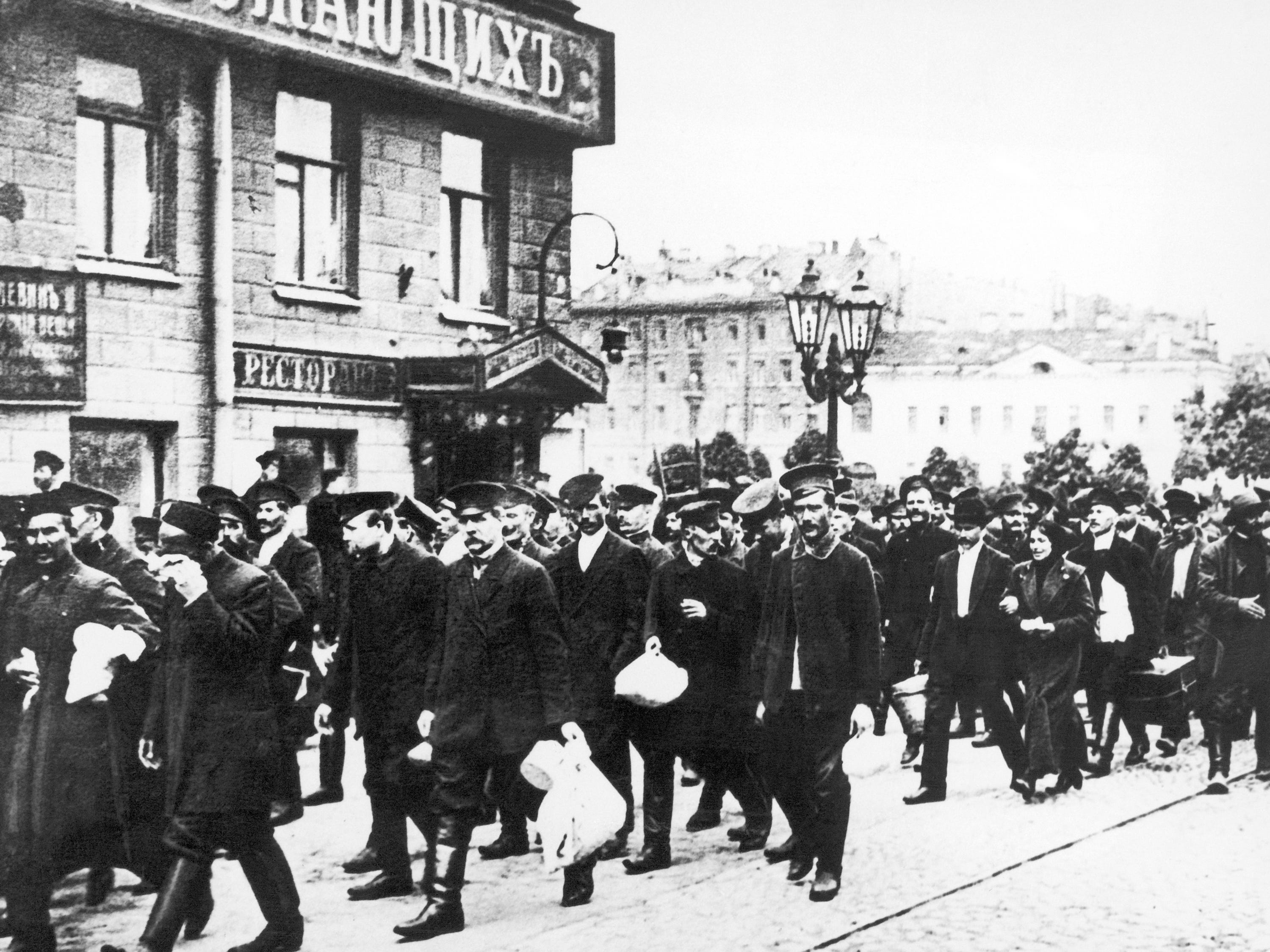 In this Aug. 8, 1914, photo, Russian reservists walk with their belongings in St. Petersburg, Russia. Russia entered World War I with a massive but badly armed army.