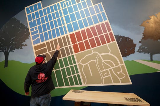 Mark Mahoney, co-founder of Stock House Brewing, points to a map of Wauwatosa's east side, part of a wall-length mural in the taproom of the brewery. Stock House is expected to open at 7208 W. North Ave., in Wauwatosa, soon.