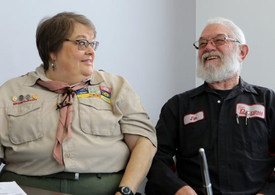 Lynn and Jim Seif received Certificates of Merit from the Three Harbors Boy Scout Council for saving the life of a coworker at Russ Darrow KIA in Wauwatosa.
