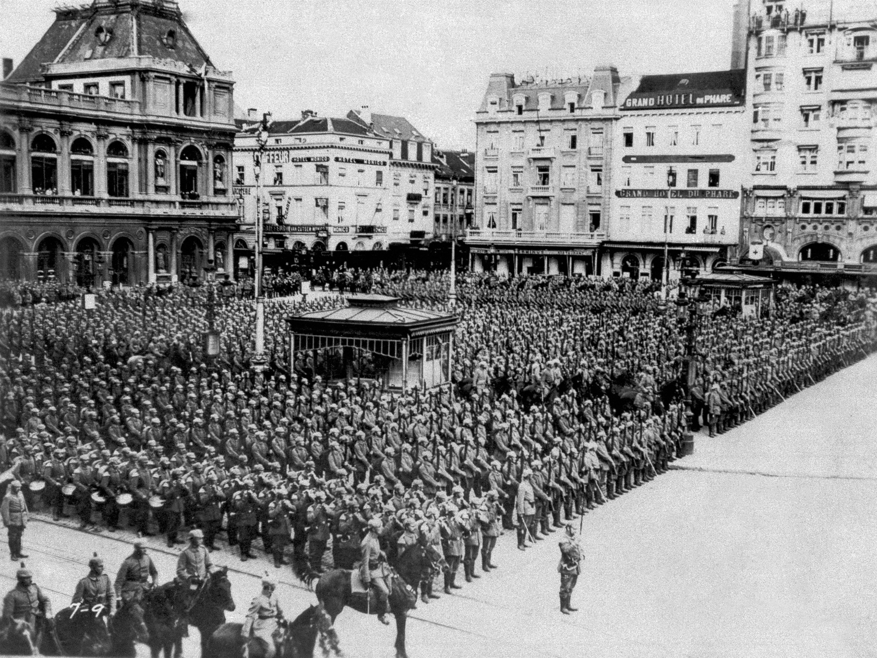 In this August 1914 photo, German troops stand in formation during the occupation of Brussels.