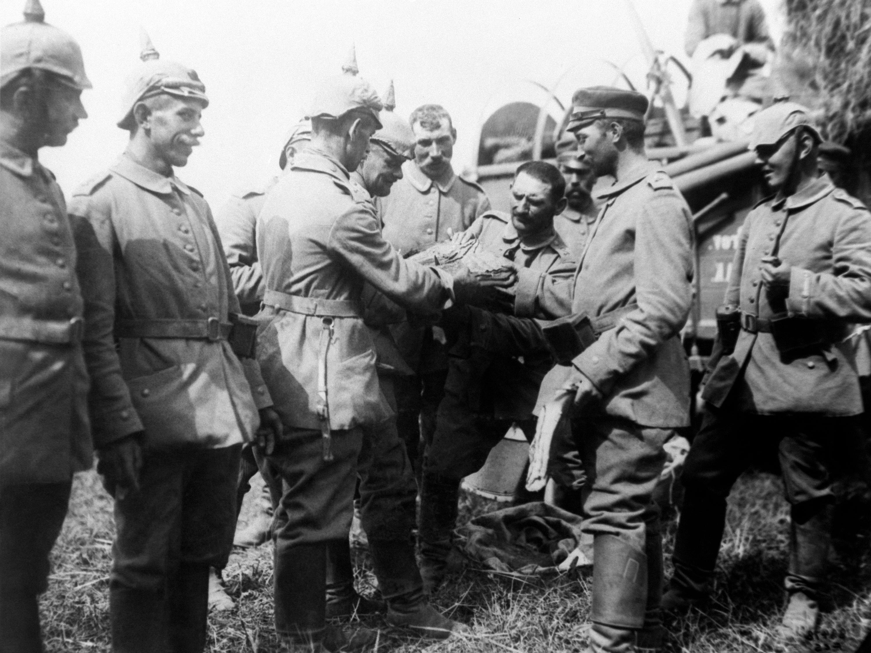 In this 1914  photo, German army troops receive rations from a field transport while advancing toward Brussels. In mid-August 1914, the German army launched its assault on Brussels.