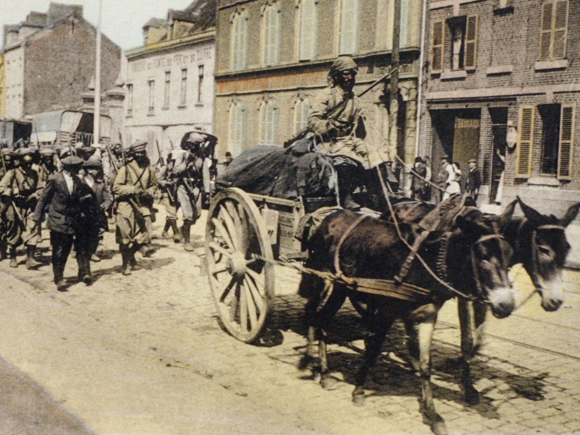 A photo of a postcard released by the Historial de Peronne (WWI Museum) of African troops from the French colonies in the streets of Amiens in 1914 before the Battle of the Somme during the World War I.