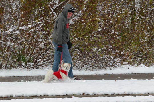 Were it not for the red sweater, 2 year-old Teddy would blend in with the newly fallen snow while taking his daily walk with owner, Jim Pingitore along Menomonee Parkway in Wauwatosa.