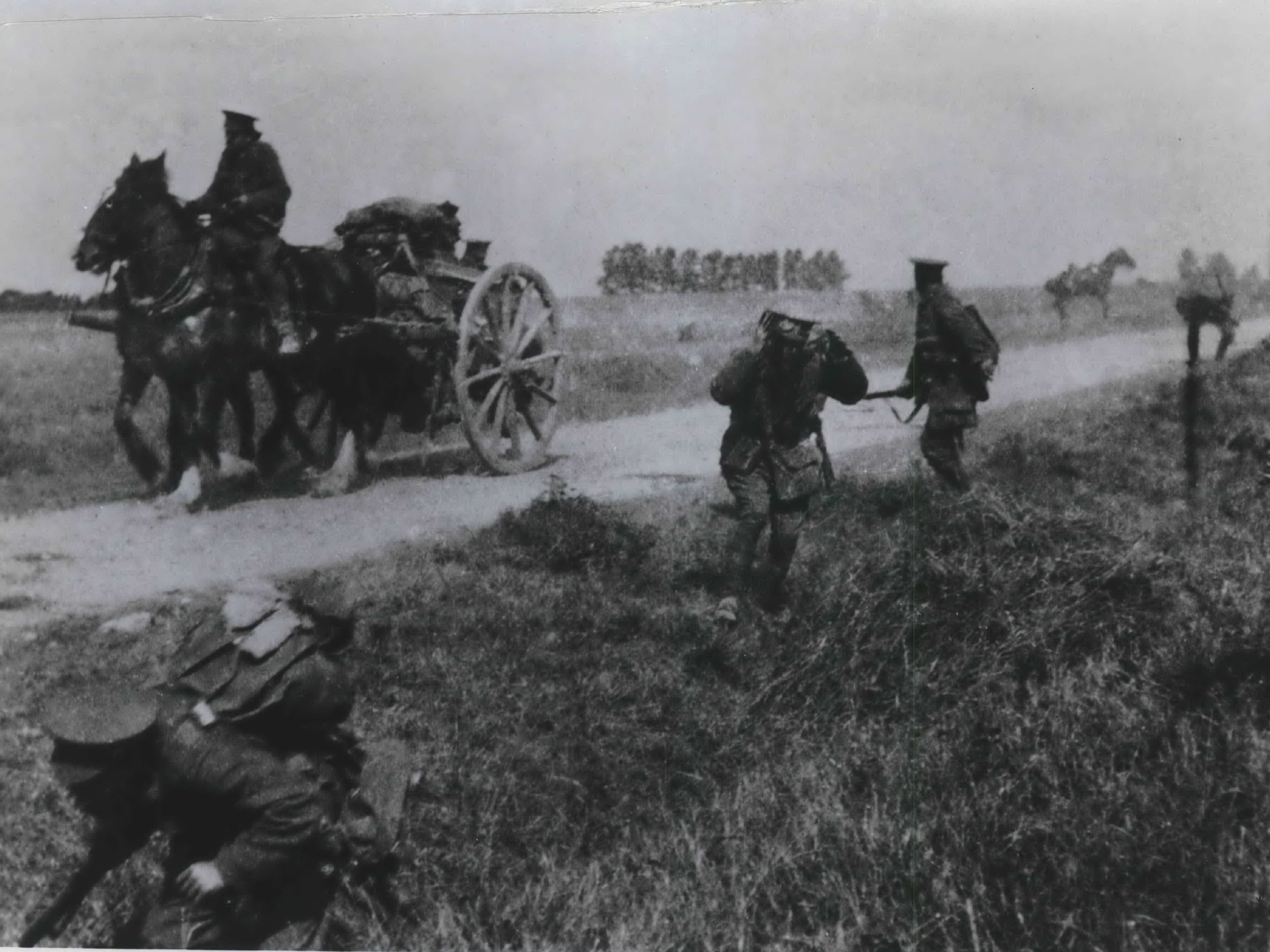 "British soldiers duck for the safety of a ditch as artillery shells burst near a transport wagon. This rare action photograph was taken Sept. 8, 1914, during the First Battle of the Marne and appears in ""The American Heritage History of World War I,"" published Oct. 15, 1964."