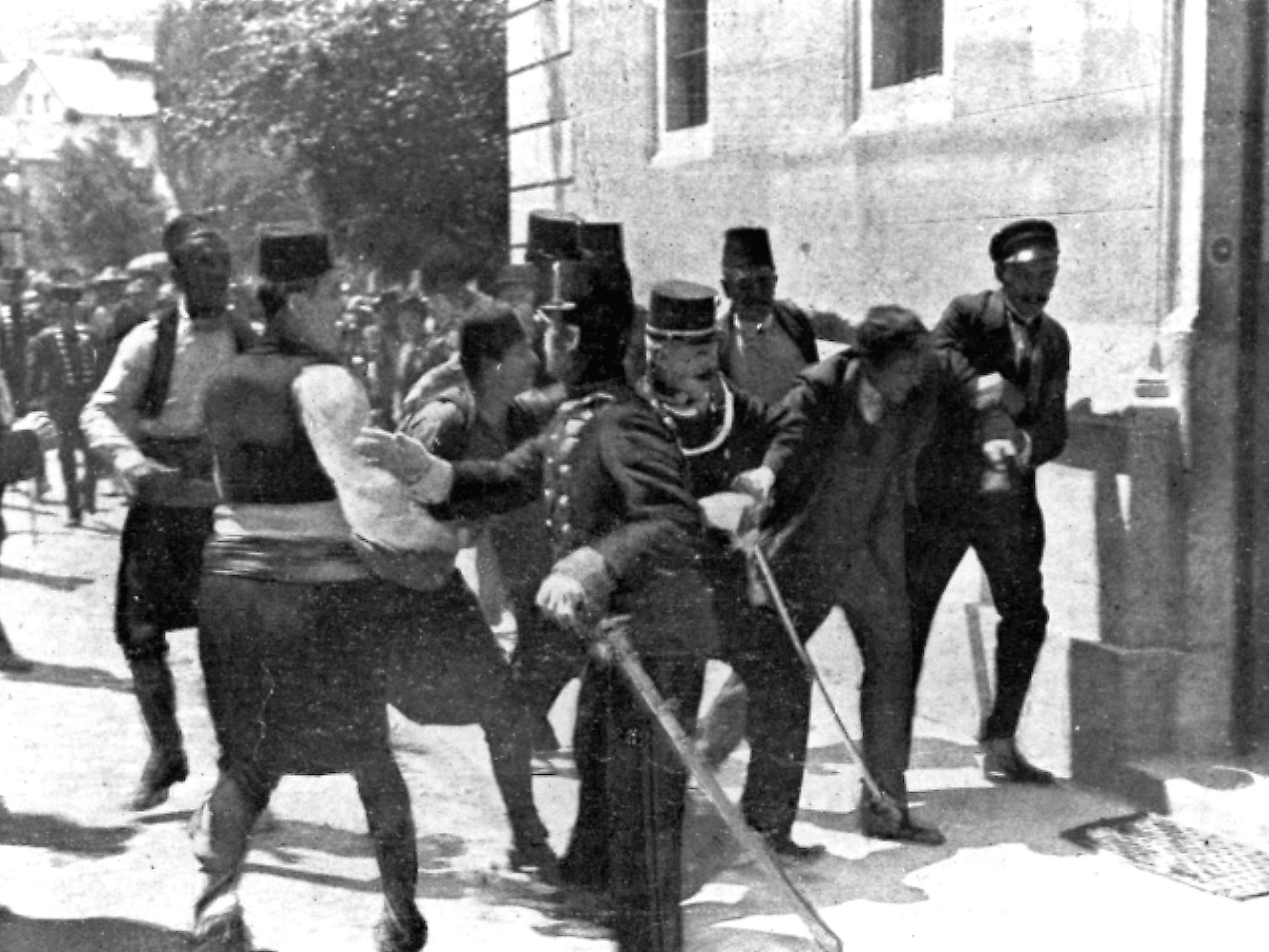 In this June 28, 1914, file photo, police pursue a suspect after the shooting of Austria's Archduke Franz Ferdinand in Sarajevo, Yugoslavia. Young Serb nationalist Gavrilo Princip fired the shots that assassinated Ferdinand, heir to the Austrian-Hungarian throne, and his wife Sophie.