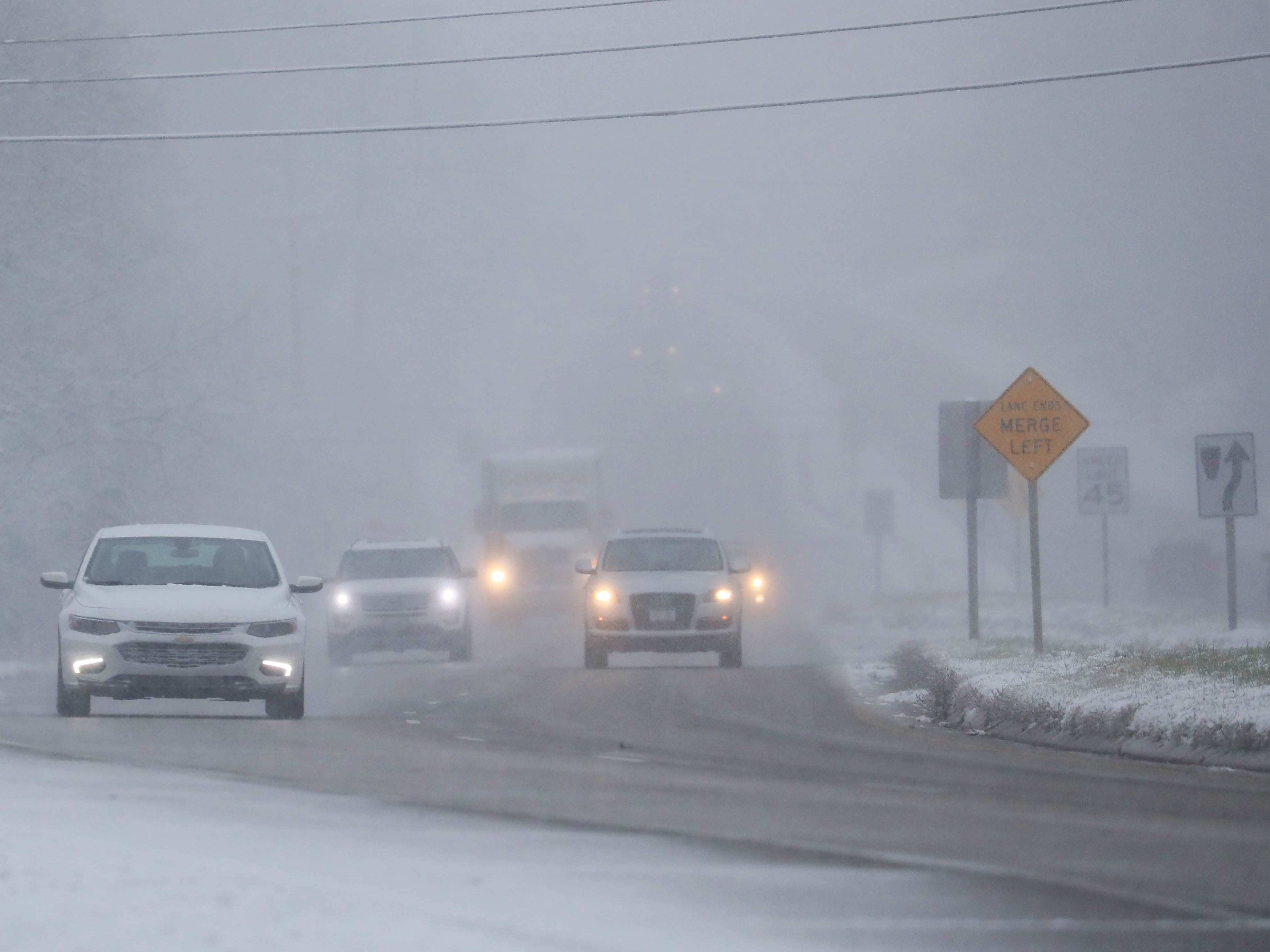 Drivers are greeted by winter's return as they head south on Highway 83 in Delafield.