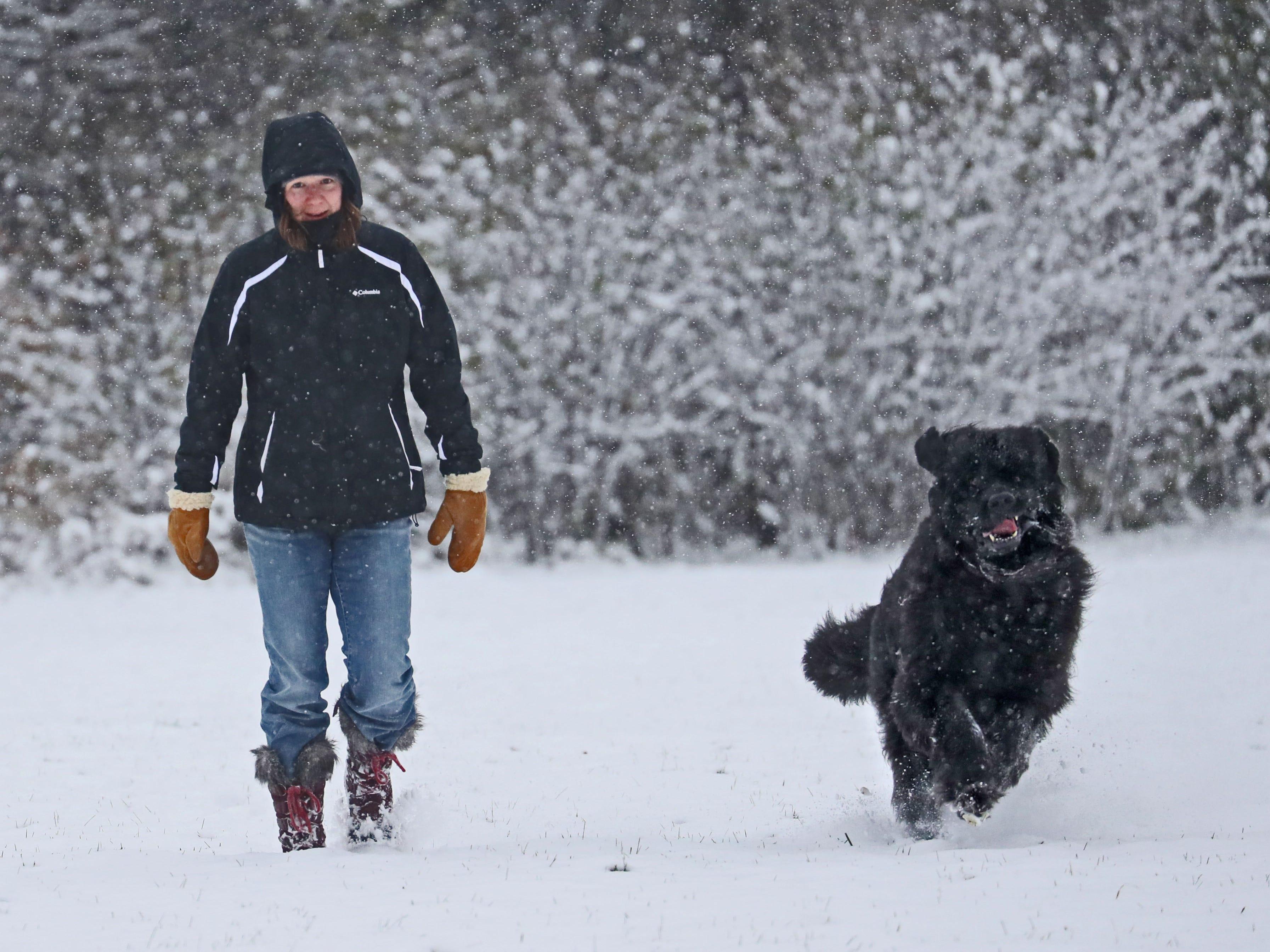Hope Erickson of Delafield walks her dog Fergus in the dog run at Nashotah Park in Waukesha County.