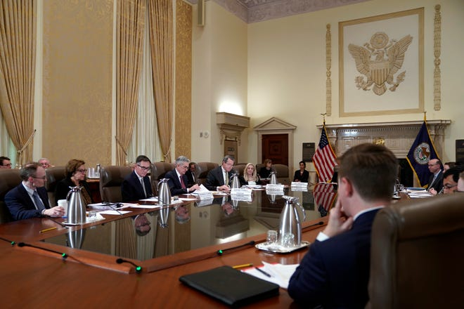 The Federal Reserve Board, including chair Jerome Powell (fourth from left), holds a meeting Oct. 31 in Washington.