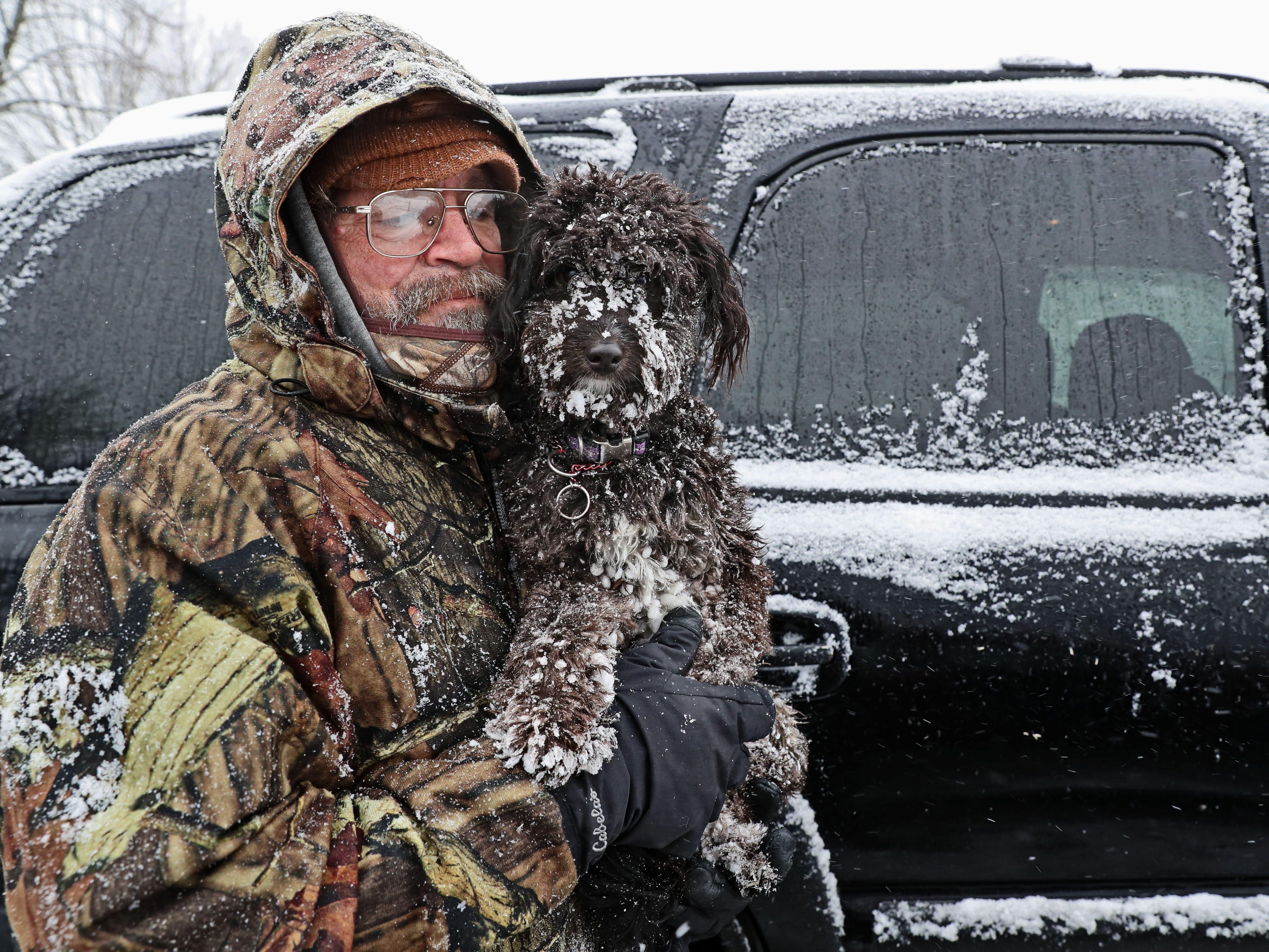 Steve Payne of Stone Bank and his dog Geordi finished up their morning walk at the dog run in Nashotah Park near Nashotah in Waukesha County.