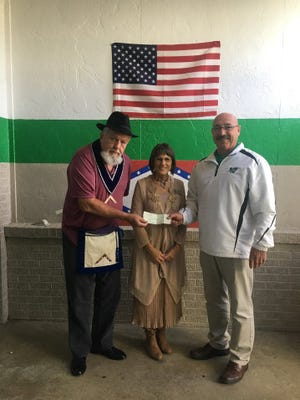 "Michael Sanders (from left), Worshipful Master of Yellville Masonic Lodge #117 recently presented a $350 check to Liz Leatherman and Wes Henderson of Yellville-Summit Public Schools. The check was presented by the Masonic Lodge as the first of an annual donation for the continuing ""Shoes for Kids"" fund. This is one of the many community service projects undertaken by the Yellville Masonic Lodge #117 to make a positive impact in the local community."