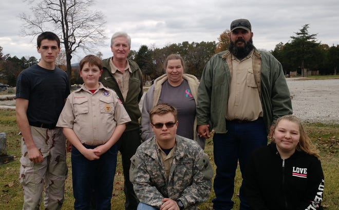 Boy Scout Troop 156 and Cotter's Joe P. Joslin Jr. American Legion Post 23 spent Sunday placing American flags at the gravesides of veterans buried at the Gassville Cemetery. Although it was a bit cold and windy, the task was completed. Pictured are: Logan Simpson, Bryson Simpson, Randy Simpson, Nathan Horn, Tia Horn, Bobby Horn, and Mikayla Horn.