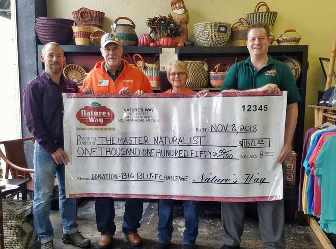The annual Big Bluff Challenge raised $1,150 for the North Central Arkansas Master Naturalists. Pictured are: (from left) Jake Anderson, race director and owner of Norfork Adventure Supply; Daniel Foster and Debbie Rees of the Master Naturalists; and Duncan Clayton, General Manager of title sponsor Nature's Way.