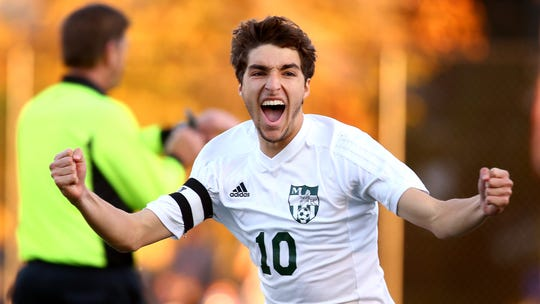 Morris Knolls Tommy Scalici celebrates after kicking a game-winning PK vs. Montclair during their NJSIAA North 1 Group IV final at  Fortunato Field in Montclair. The Golden Eagles defeated top seed Montclair 3-2 double-overtime. November 8, 2018, Montclair, NJ