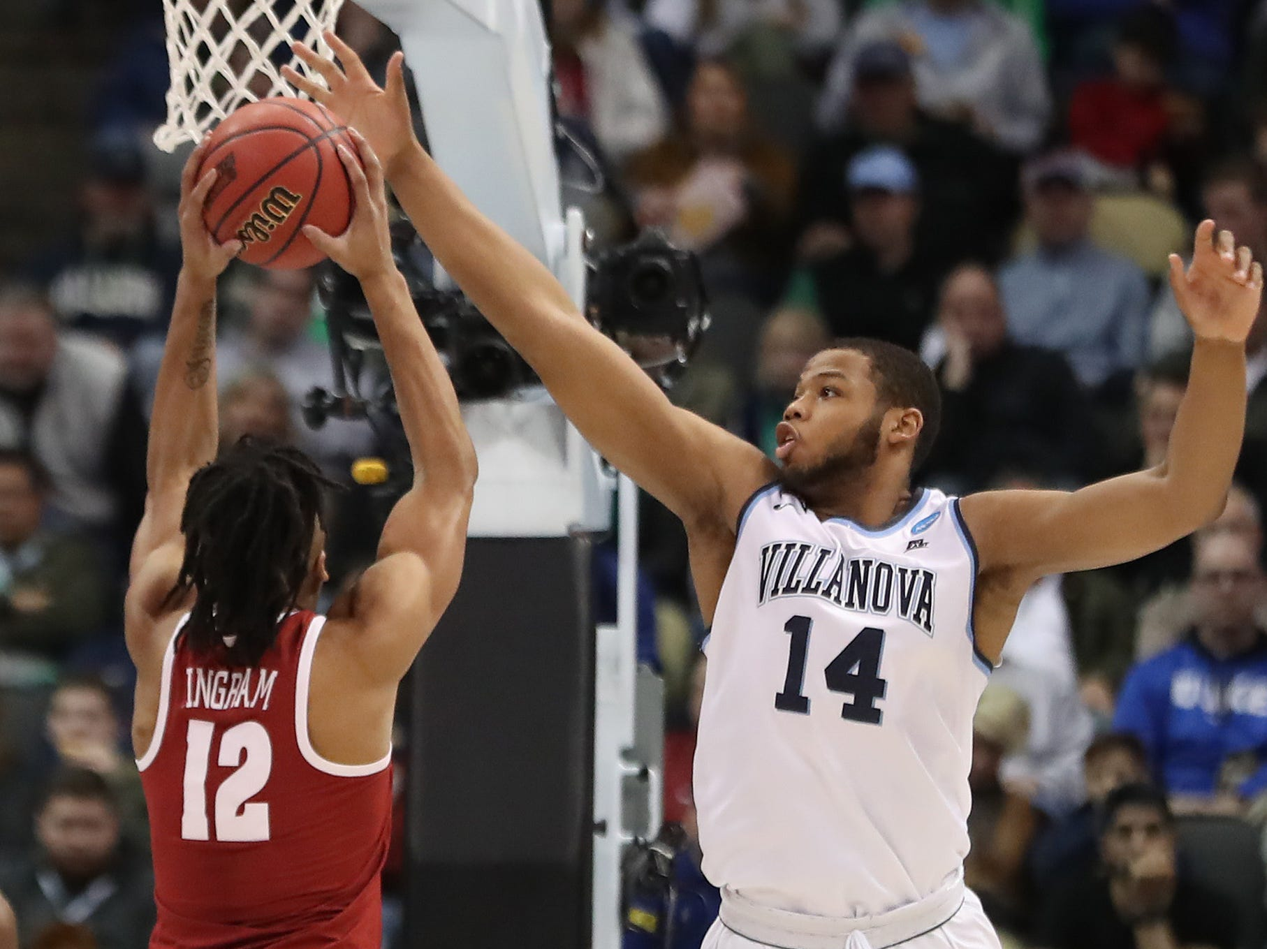 Mar 17, 2018; Pittsburgh, PA, USA; Villanova Wildcats forward Omari Spellman (14) blocks the shot of Alabama Crimson Tide guard Dazon Ingram (12) in the second round of the 2018 NCAA Tournament at PPG Paints Arena. Mandatory Credit: Geoff Burke-USA TODAY Sports