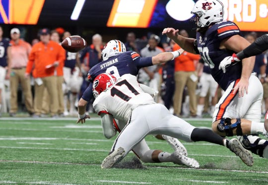 Georgia linebacker Davin Bellamy (17) sacks Auburn Tigers quarterback Jarrett Stidham (8) and forces a fumble during the SEC Championship game at Mercedes-Benz Stadium on Dec. 2, 2017, in Atlanta