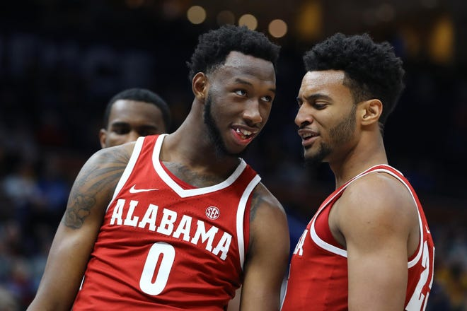 Mar 8, 2018; St. Louis, MO, USA; Alabama Crimson Tide forward Donta Hall (0) reacts with guard John Petty (23) after scoring a basket during the second half of the second round of the SEC Conference Tournament against the Texas A&M Aggies at Scottrade Center. Alabama won 71-70. Mandatory Credit: Billy Hurst-USA TODAY Sports