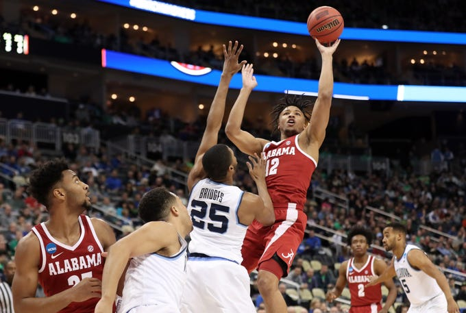 Mar 17, 2018; Pittsburgh, PA, USA; Alabama Crimson Tide guard Dazon Ingram (12) shoots against Villanova Wildcats guard Mikal Bridges (25) during the first half in the second round of the 2018 NCAA Tournament at PPG Paints Arena. Mandatory Credit: Geoff Burke-USA TODAY Sports