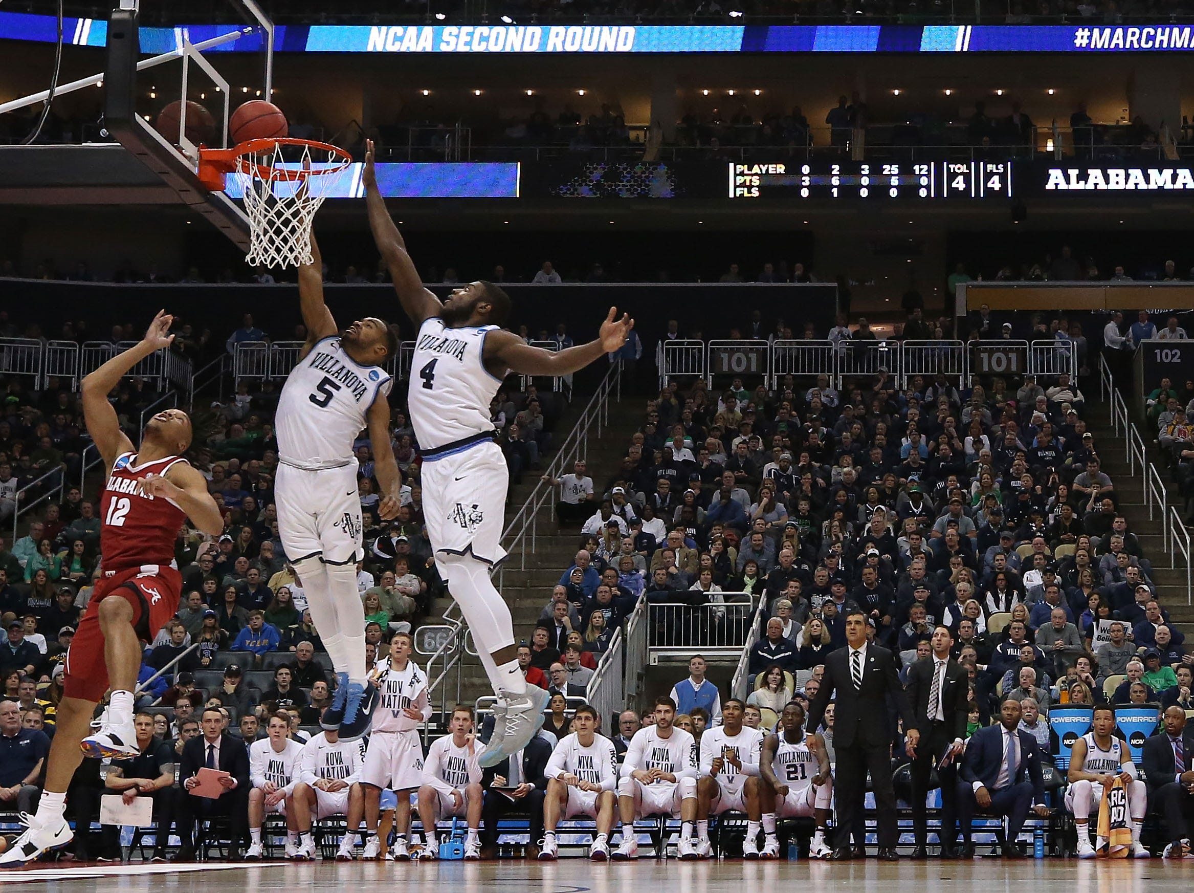Mar 17, 2018; Pittsburgh, PA, USA; Villanova Wildcats guard Phil Booth (5) blocks the shot of Alabama Crimson Tide guard Dazon Ingram (12) in the second round of the 2018 NCAA Tournament at PPG Paints Arena. Mandatory Credit: Geoff Burke-USA TODAY Sports