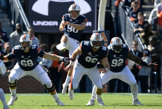 Arryn Siposs punts against Texas A&M at Auburn football on Saturday, Nov 3, 2018 in Auburn, Ala.