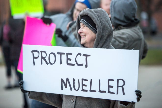 Around 40 protesters attend a rally in front of Muncie's City Hall on Thursday to show support for the Robert Mueller investigation after Attorney General Jeff Sessions' departure fromthe Justice Department. The Muncie rally was one of 900 taking place nationwide.