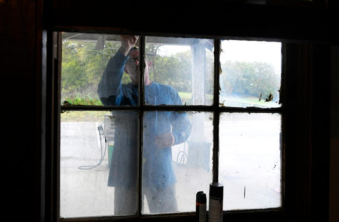 Norm Gielda cleans windows while restoring the 90-year-oldDavis General Storein the Boston community in Williamson County. Norm and his wife, Teresa, purchased the store in March 2018.