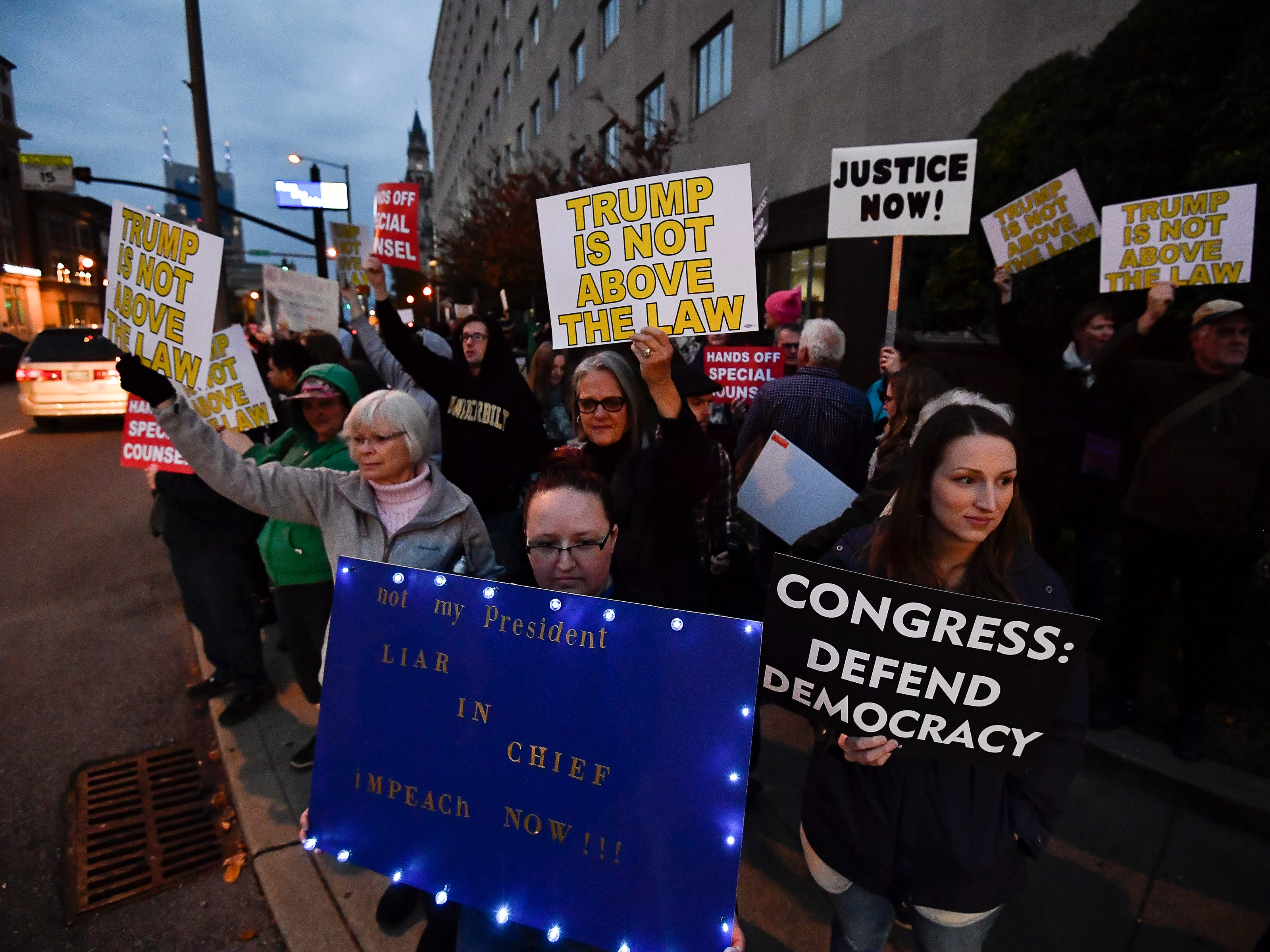 "Protesters gather for a ""Nobody is Above the Law Rally"" on Broadway outside the Estes Kefauver Federal Building & Courthouse Thursday, Nov. 8, 2018, in Nashville, Tenn."