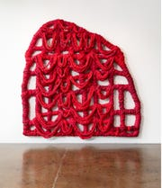 """Vadis Turner, """"Red Gate,"""" 2018, braided bedsheets, fabric dye, acrylic paint, acrylic resin, thread and wood, 118""""x120""""x10""""."""