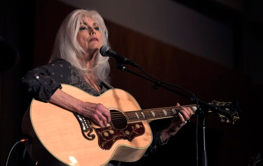 Emmylou Harris performs a song for Charles Strobel during the 25th Annual Joe Kraft Humanitarian Award Luncheon honoring Strobel on Friday.