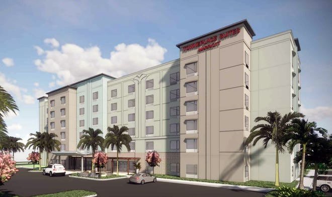 A rendering of TownePlace Suites Marriott hotel under construction across Juliet Boulevard from the Walmart Supercenter on the south side of Immokalee Road west of Interstate 75 in North Naples.
