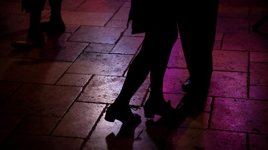 People dance during a performance by the Dazzling DelRays on Friday, October 12, 2018, at Dogtooth Sports and Music Bar in Naples.