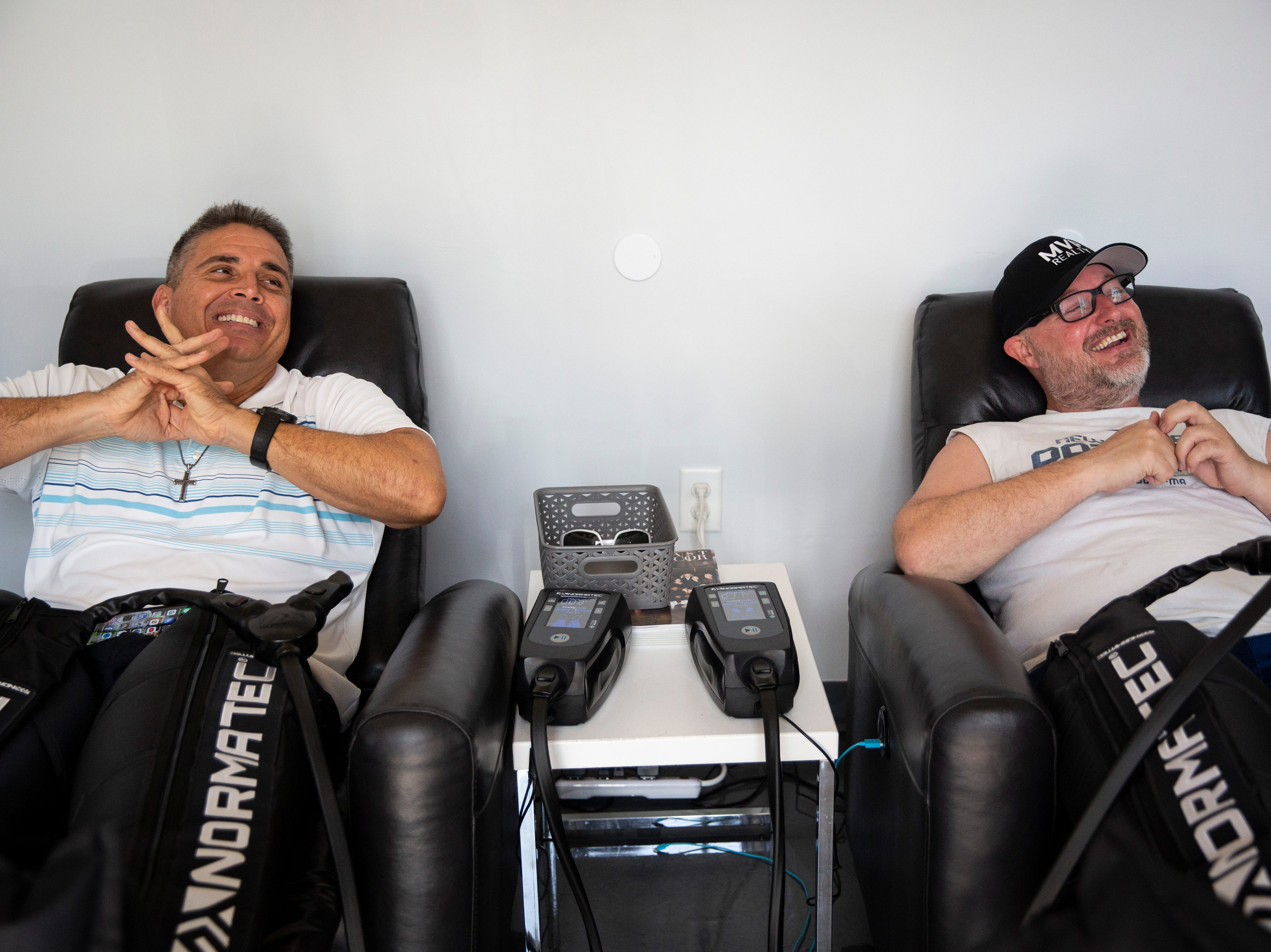 Patrick Dearborn, left, and Derek Carlson, right, receive NormaTec compression after their full body cryotherapy on Thursday, Nov. 8, 2018, at US Cryotherapy in North Naples. Carlson and Dearborn have known each other for over a decade, and Carlson is the one who pushed Dearborn to start receiving cryotherapy.