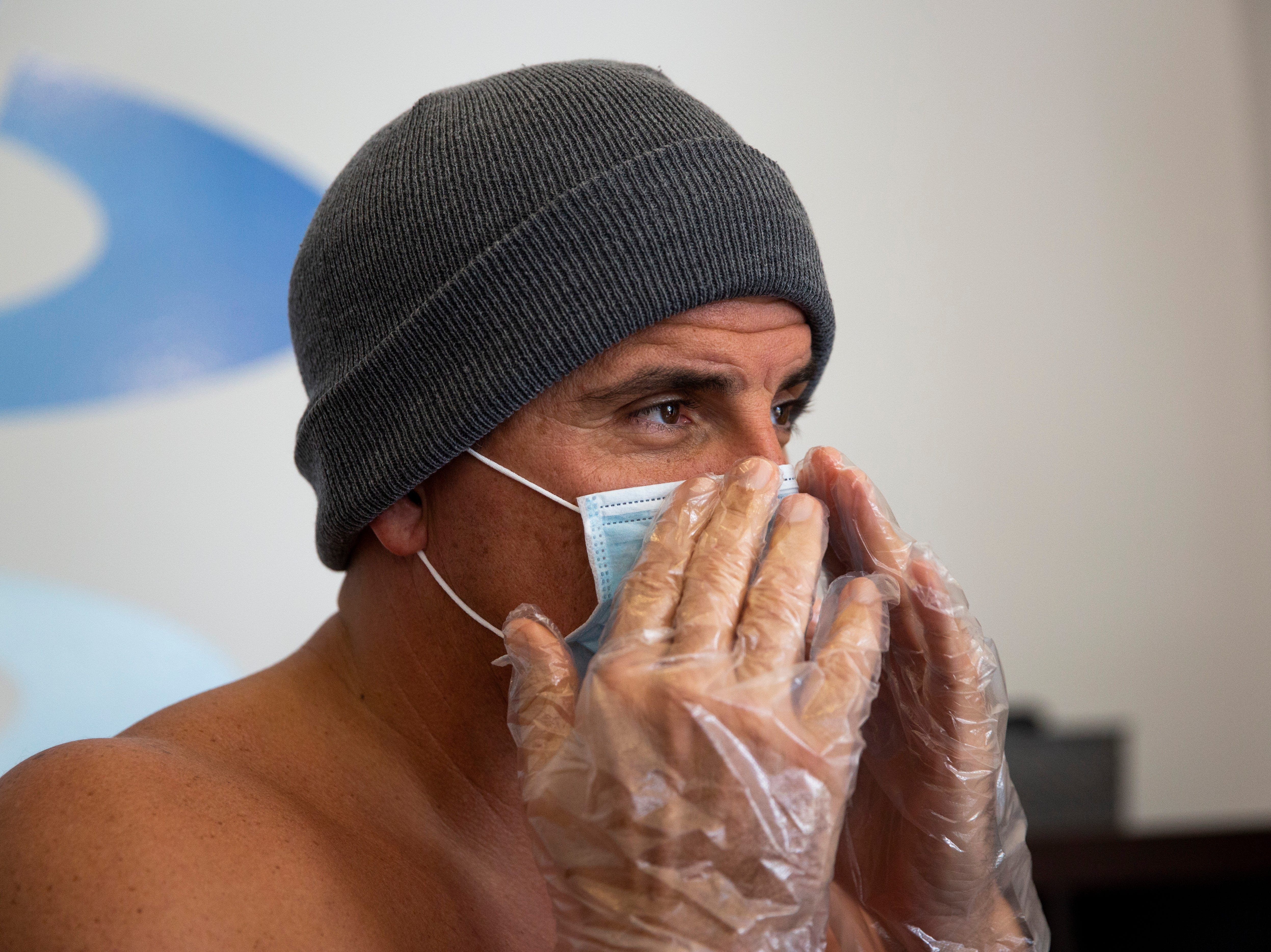 Patrick Dearborn adjusts his mask before receiving whole body cryotherapy in the single room chamber on Thursday, Nov. 8, 2018, at US Cryotherapy in North Naples. Dearborn started receiving cryotherapy in August and comes in about five times a week.