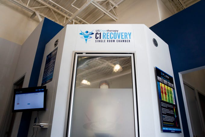 "Derek Carlson receives whole body cryotherapy in the single room chamber on Thursday, Nov. 8, 2018, at US Cryotherapy in North Naples. Carlson has had two major injuries and says cryotherapy has helped his recovery immensely. ""They've put me back together,"" he said."