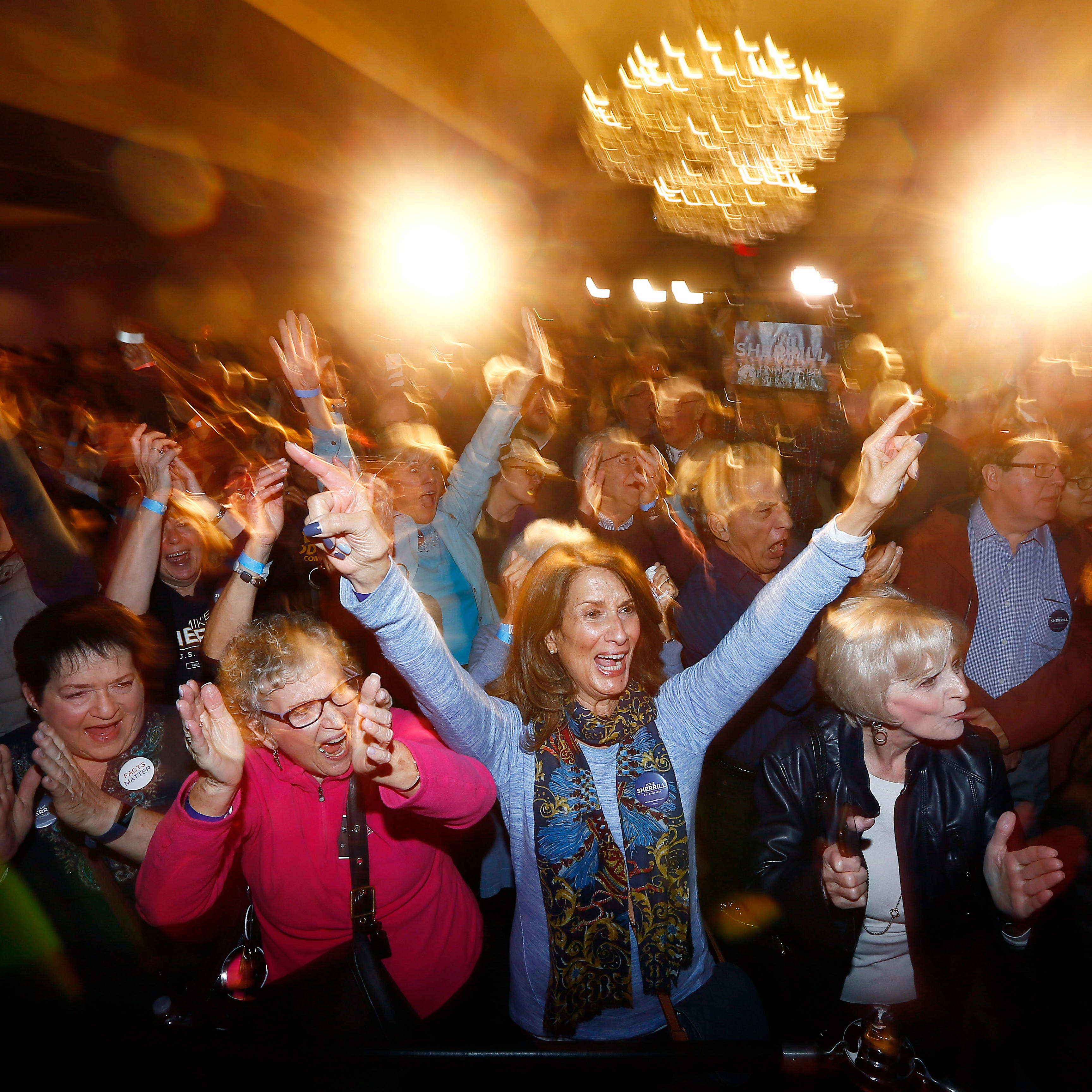 Supporters of Mikie Sherrill explode into cheers as CNN names her the winner for the NJ 11th Congress seat at the Parsippany Sheraton.