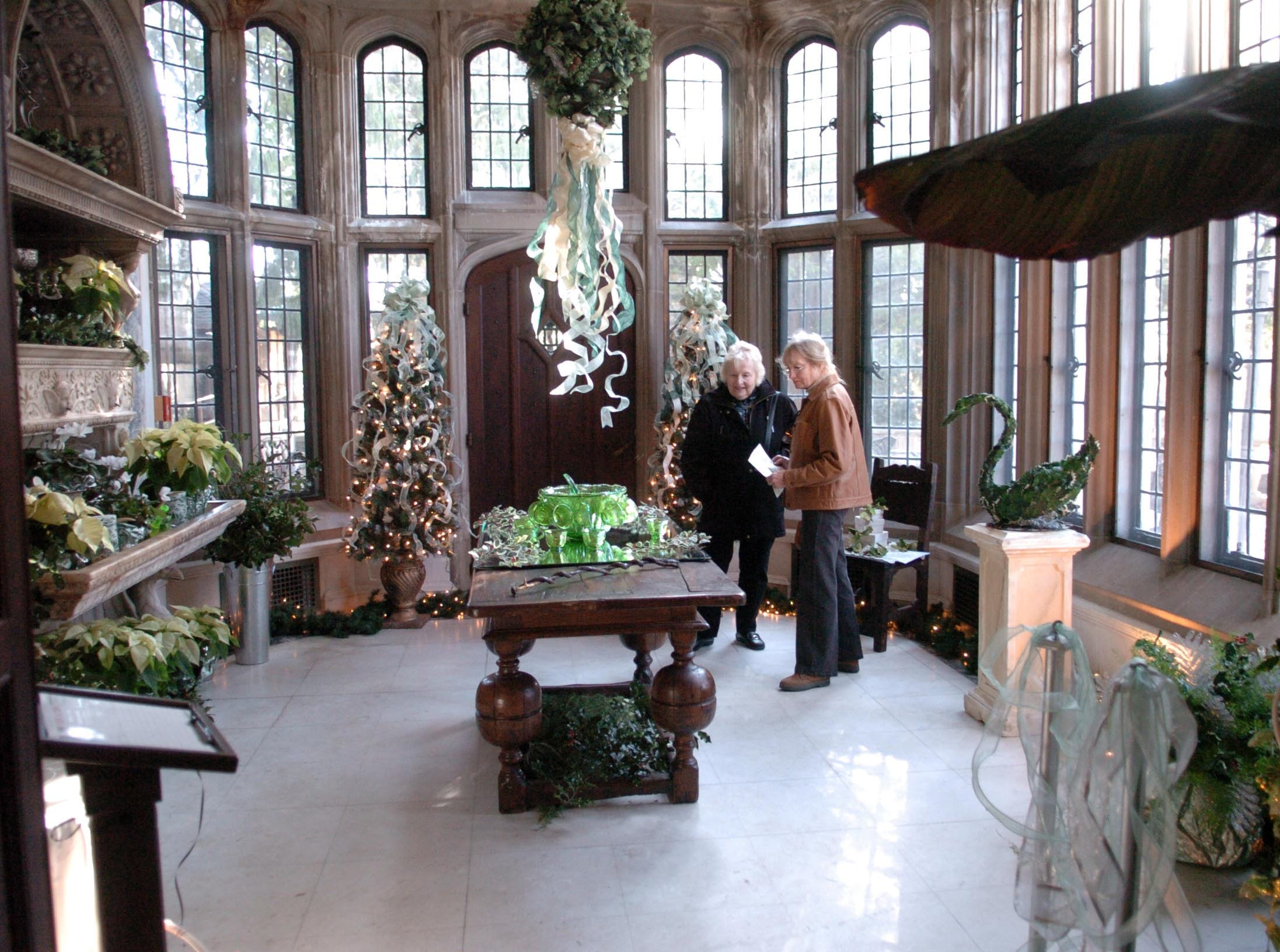 Judith Bott and Ellen Brooks admire a room at Skylands Manor during a Skylands Association holiday open house on Dec. 1, 2011.