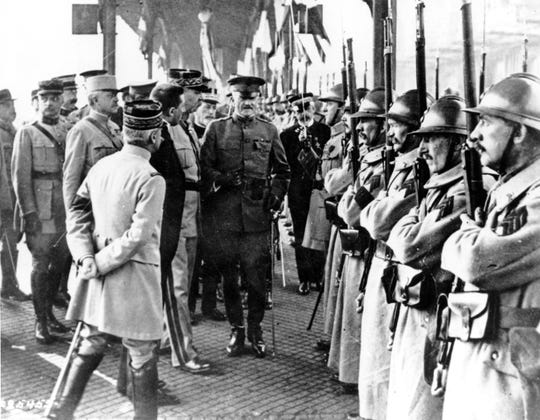U.S. Army General John J. Pershing, center, inspects French troops at Boulogne, France in June 1917 during World War I.   (AP Photo, File)