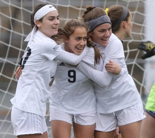 Carly Sherman, Emily Holzer and Abby Rozen of Demarest celebrate a first half goal scored by Holzer.