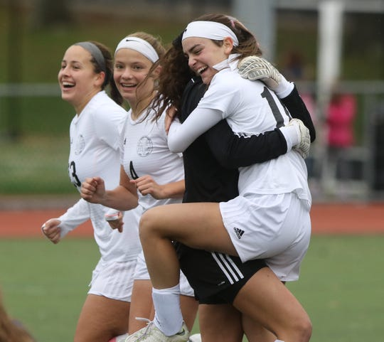 Izzy Urquiola, Elizabeth Argenziano, goaltender Emma Miller (dark jersey) and Carly Sherman could celebrate Northern Valley at Demarest winning a division title, as well as reaching the Bergen County semifinals for the first time in program history.