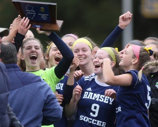 Ramsey celebrates their North 1, Group 2 girls soccer sectional title.