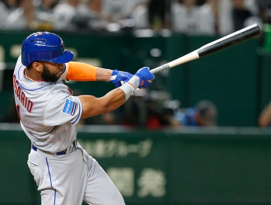 MLB All-Star shortstop Amed Rosario of the New York Mets hits a solo home-run off All Japan's starting pitcher Takayuki Kishi in the third inning of Game 1 of their All-Stars Series baseball at Tokyo Dome in Tokyo, Friday, Nov. 9, 2018. (AP Photo/Toru Takahashi)
