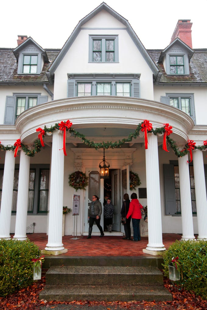 People exit Ringwood manor after viewing the Annual Victorian Christmas display at the manor in Ringwood State Park.