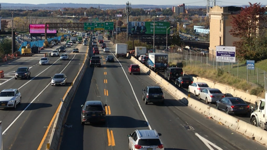 Traffic traps motorists on an access road parallel to westbound Route 495 in North Bergen while vehicles move quickly along the highway despite a $150-million construction project.