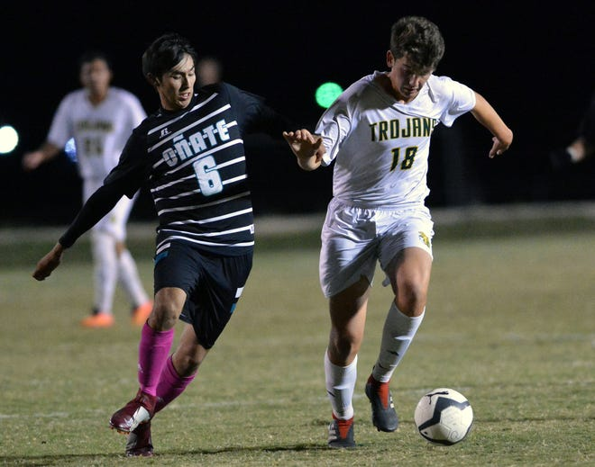 Trevor Suggs (18) for Mayfield High gets by Oñate's Jesus Ortiz at Field of Dreams Soccer Complex during a match on Oct. 9.