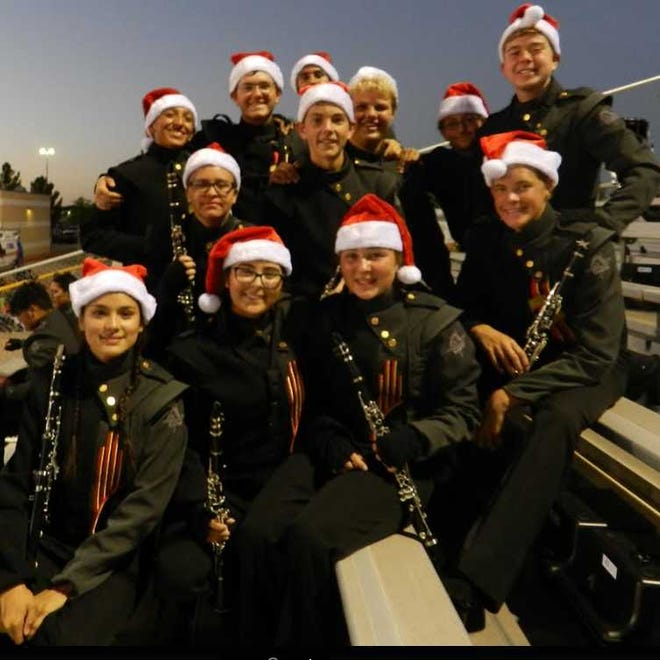 Students from the Centennial High School Band gear up for their holiday craft fair.