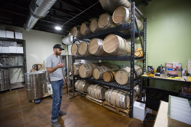 Chris Schaefer, owner and operator of Dry Point Distillery in Las Cruces, with barrels for aging brandy and bourbon, Friday November 9, 2018.