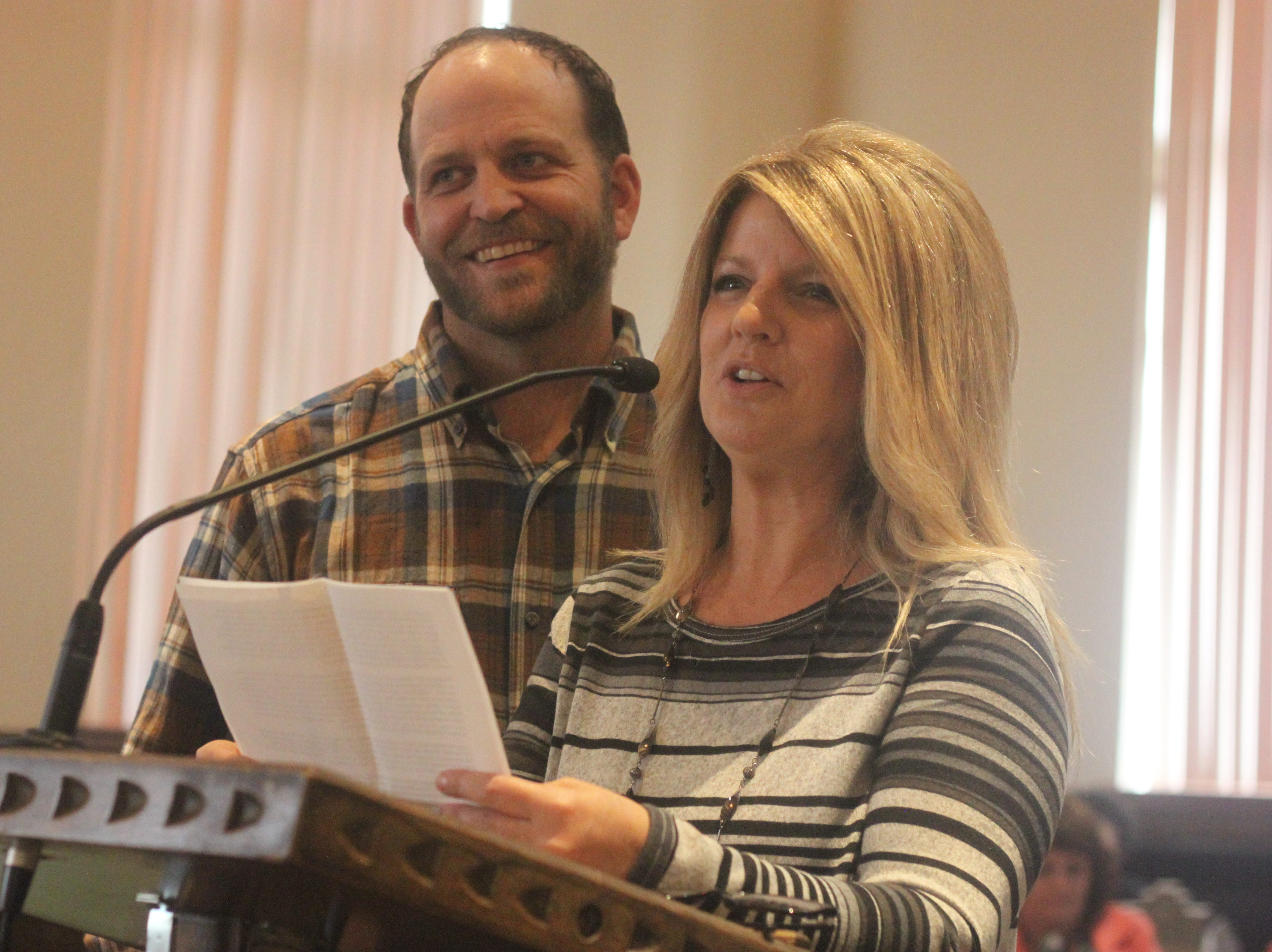 Adoptive parents JD Brown (left) and his wife Trisha Brown speak during Adoption Day, Nov. 9, 2018 in the Eddy County Courthouse.