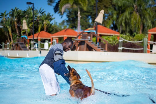 U.S. Air Force Staff Sgt. Jeffrey Greene, a military dog trainer assigned to the 6th Security Forces Squadron, practices water aggression training with 6th SFS military working dog, Lleonard, at Adventure Island, Tampa, Fla. Oct. 29, 2018. This training allows military working dogs to become more confident working in water environments and prepares them to take on any mission.