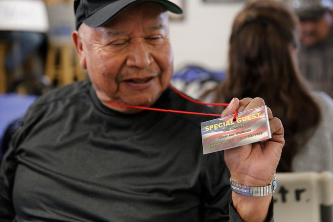 Army veteran Keith Tsosie shows a message printed on a card he received at the Giving Thanks for Our Veterans lunch on Friday at the Farmington Indian Center.
