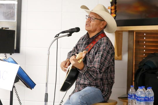 Veterans and family members listened to Shiprock resident Wally Mac sing country songs at the Giving Thanks for Our Veterans on Friday at the Farmington Indian Center.